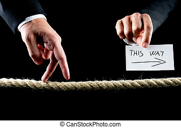 Metaphoric image of male hand walking on frayed rope towards success.