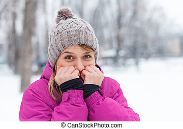 Picture of a cute young girl being cold outside