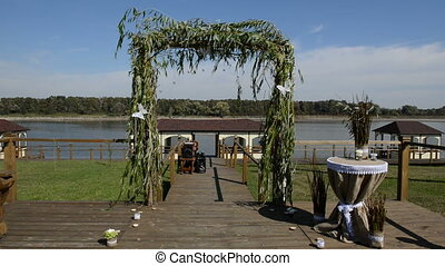 The wedding arc decorated with white butterflys which move...