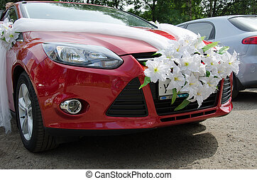The wedding car with an ornament