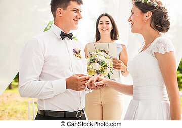 The wedding ceremony - Brides, where the groom wears a ring...