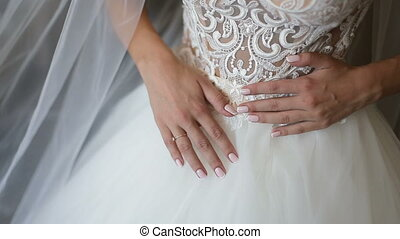 The Wedding Dress - Brunette bride wears white robe and veil...