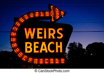 The Weirs Beach sign at night, in Laconia, New Hampshire