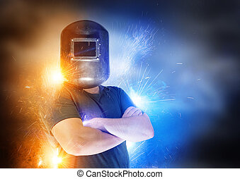Dramatic shot of a welder with blue and yellow sparks.