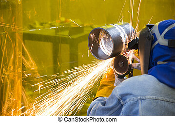 The welding craftsman grinding the steel tube