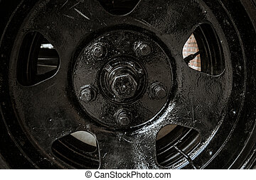 The wheel of the old Soviet military machine. In the park of the exhibits of military equipment