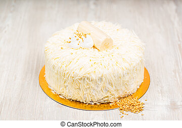 The white cake and nuts on the table