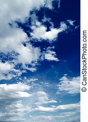 The white clouds. - The white clouds on background sky.