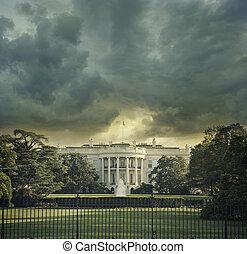 The White House in Washington DC under dark stormy clouds