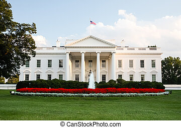 The official residence of the President of the United States in Washington, D.C. lit by the setting sun in the evening.