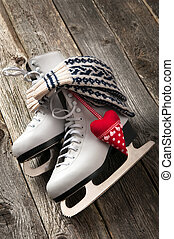 The white ice skates on old wooden boards