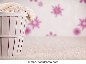 The wicker basket in pink room