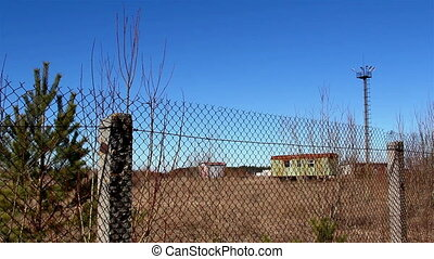 The wide metal wire fence and the view inside it