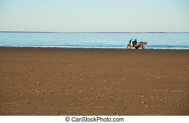 The wide sandy beach of lake and a flat horizon
