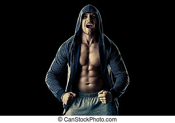 the will to win - Athlete man bodybuilder strains all...