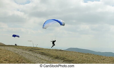 the wind blows paraglider - the wind blows away the...