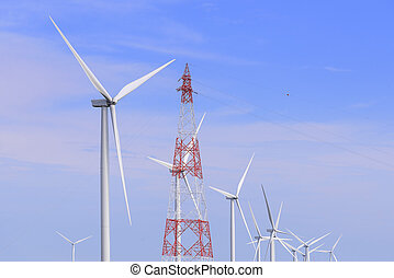 The wind turbine farm and the electric pylon with the sky and cloud