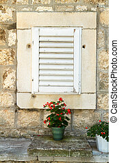 The window with shutters of the old house in Korcula