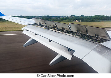 The wing of the aircraft with flaps open when landing.