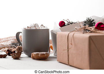 The winter composition. The gifts and cup with marshmallow...