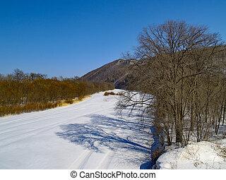 The Winter landscape - river, mountains