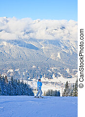 The woman at the view winter mountain. Ski resort Schladming . A