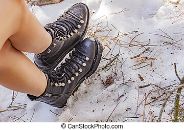 The woman boots on snow in Turkey mountains.