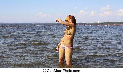 The woman dancing in water