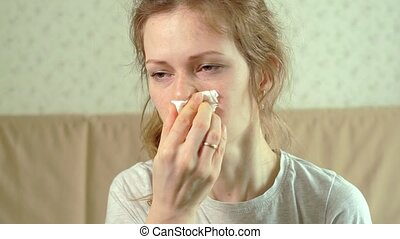 The woman hurts her nose because she has cold. 4k Teen woman...