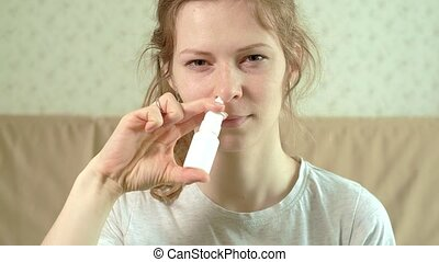 The woman hurts her nose because she has cold. sprinkles...
