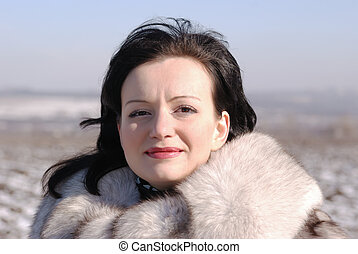 The woman in a fur coat. A fur coat from arctic fox