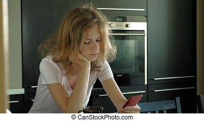 The woman in the kitchen uses the tablet, just woke up....