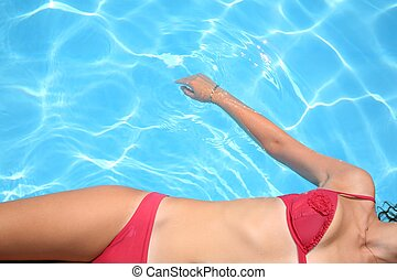 The woman lays in pool