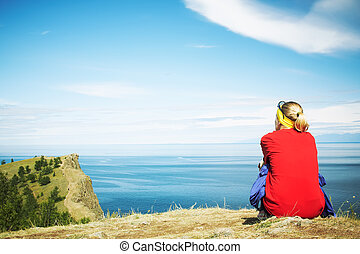 The woman looking at a beautiful landscape