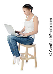 The woman on a chair with the laptop