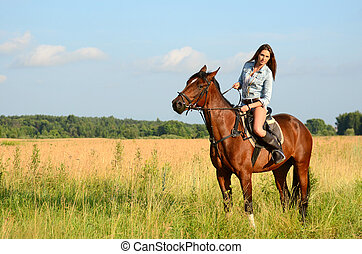 The woman on a horse in the field