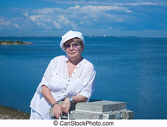 The woman on the background of the Gulf of Finland. Peterhof. Ru