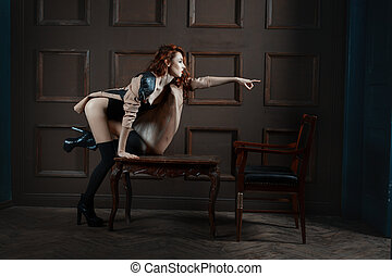 The woman points a finger bitch. - Red-haired woman points a...