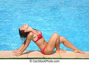 The woman poses at pool