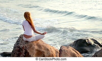 The woman practising the yoga. - The woman practising the...