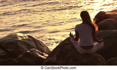 The young woman practising the yoga. holiday relaxation.
