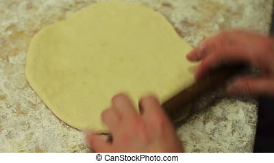 Woman working with dough. making homemade croissants