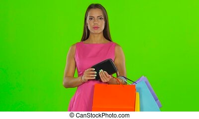 The woman shakes the wallet but no money. Green screen -...