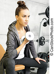 The woman trains at the gym