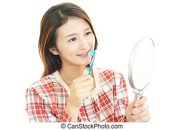 The woman who brushes her teeth