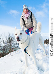 The woman with a dog in winter on walk