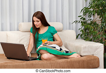 The woman with laptop.