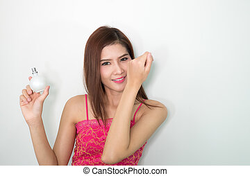 the Woman with perfume, young beautiful girl holding bottle of perfume and smelling aroma,