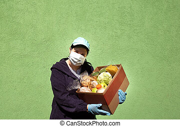 women with a box of food, help and donation of food