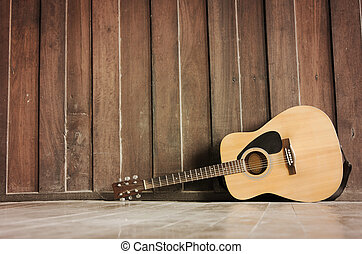 The Wood guitar against wall